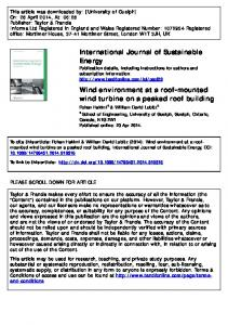 Wind environment at a roof-mounted wind turbine on